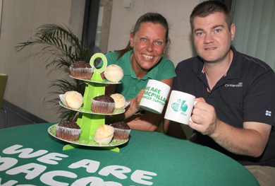 xxxx with Councillor Colin McGrath getting ready for the Macmillan Cancer World's Biggest Coffee Morning.