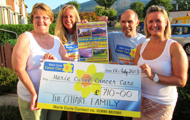 Mary O'Hare from Newcastle is pictured donating a cheque for £710 to Jacqui Mason and Paul Madden from the newly formed Marie Curie Cancer Care Newcastle area fundraining group with Mary's daughter, Kate Pell.