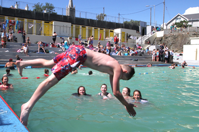 Jamie Holland take the plunge in the Newcastle Rock Pool.