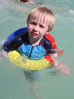 Cian Brennan (3) learning to swim in the Newcastle Rock Pool.