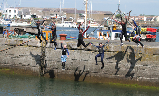 Some teenagers enjoy a dip in Ardglass harbour during a sunny spell at the weekend at the start of their summer holidays.