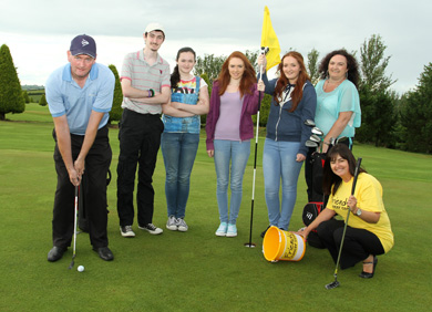 Paul Burns pictured with son, Rory, daughters, Colleen, Niamh, and Caitlin, and wife Amanda, along with Claire McAuley, of Friends Cancer Centre ready for the big golf fundraiser at Mayobridge Golf Club.