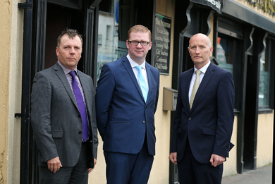 Simon Hamilton, Finance Minister, centre, with Pubs of Ulster Chief Executive Colin Neill, and Mark Stewart, Chairman of Pubs of Ulster after their meeting in the Primrose Bar in Ballynahinch.