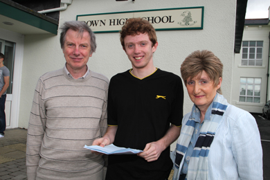 Jamie Harris, Down High School pupil from Saintfield,  pictured with his parents Micael and Jane, is set to study Computer Science at Cambridge after gaining 4 A* and 1 A.