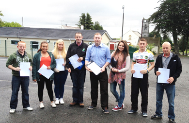 Councillor Pol o Bribin with South Down MLA Chris Hazzard, centre, launch the road safety campaign in Drumaroad.