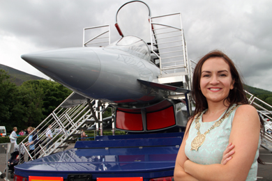 Down District Council Councillor Maria McCarthy pictured in from of the Typhoon replica model in the Aviation Village in Newcastle.