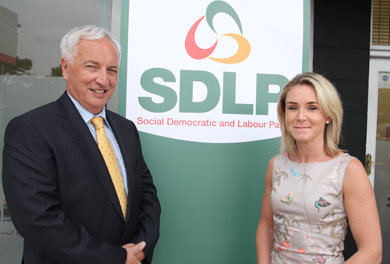 Seán Rogers MLA picture dwith Newcastle constituency office manager Laura Devlin at the launch of the new office.