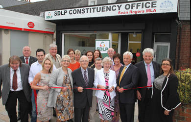 Anne O'Donaghue, wife of the late SDLP stalwart Paddy Donaghue, cuts the ribbon to open the Newcastle constituency office.