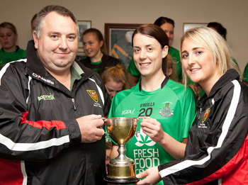 Presentation of the Senior League Trophy to Karen McMullan by County Secretary Aine McClean and Ladies Board Official Frank McMullan.
