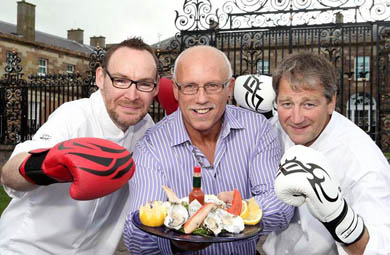 County Down's Oyster King, Colin Shirlow,  centre, pictured with local chefs Danny Millar and Derek Patterson, has won the championship eight times and holds the Guinness World Record for knocking back a whopping 233 oysters in just three minutes.