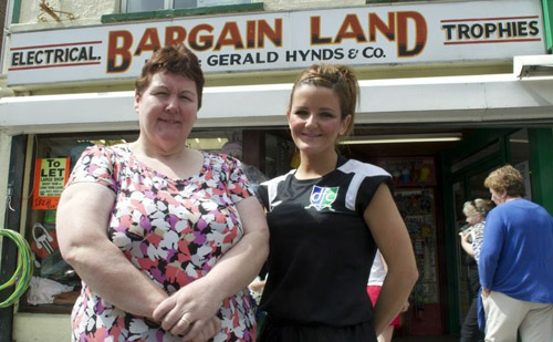 Lorriane Hynds of Bargainland Stores in Downpatriick receives her voucher for a meal fro two at Downpatrick Cricket Club from Downpatrick FC committee member, Kerry Fisher.