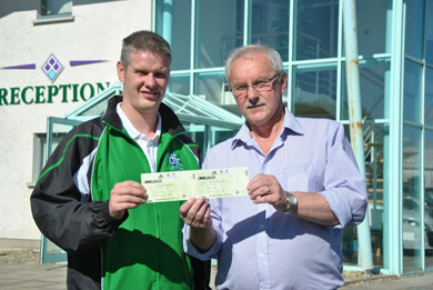 Tony McShane, Downpatrick FC committee member, presents Jim Masson of Down News with two tickets to the Northern Ireland / Portugal Qorld Cup Qualifier.
