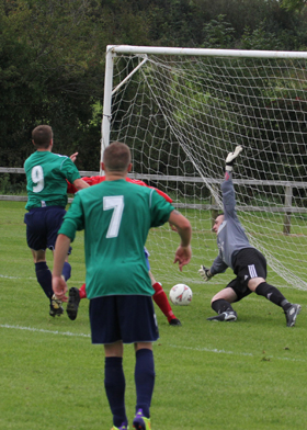 A persistent Stephen Galbraith squeezes the ball past the Islandmagee keeper.