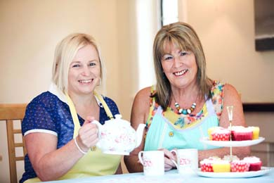 Patricia Kidd  (right) and Joan Burden from the charity are urging people to get the kettle on this Autumn and help local families affected by cancer. Donations from this year's Hug in a Mug campaign will support NICFC and the charity's brand new Daisy Lodge therapeutic short break centre, which is currently being built.