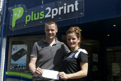 Gavin Oakes of Plus2Print  receives his voucher from Kerry Fisher, Downpatrick FC Committee member.