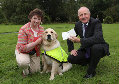 Lavinia Abrol from Ballykinlar receives a cheque for £!000 from William Burgess of the Progressive Building Society.