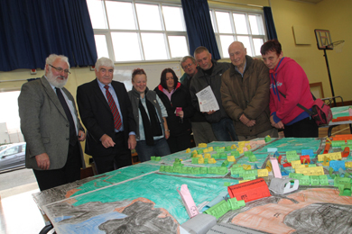 Mentor Consultant  Frank Dolaghan and Cllr Dermot Curran, left, with local residents from Ardglass during the community consultation in St Nicholas' Primary School.