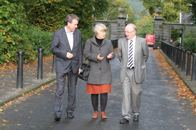 At the front gate of Castlewellan Forest Park are Paul Mullan, LHF with Sally Montgomery and Michael Burns of Castlewellan Futures.