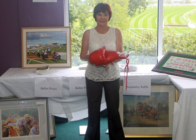 Clare Fitzsimmons tries Barry Mc Guigan's signed boxing gloves for size – Equestrian Life will have a full list and details of the charity auction in next week's edition