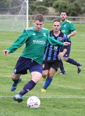 Conor clears the ball after a UUJ attack.