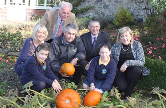 Pupils from Drumlins Integrated Primary School, Ballynahinch, celebrate their win in the Allianz scarecrow competition with an autumnal visit to CAFRE Greenmount campus where they were presented with saplings for their school. They were joined by (l-r) teacher Jackie Codd, Brian Small IEF, Martin Wooster CAFRE, Nick Crawford of Allianz and Principal Janice Marshall