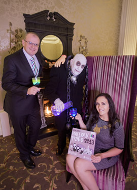 Toasting Hallowtides 2013 with Stephen Meldrum, General Manager of the Slieve Donard Resort & Spa, Uncle Fester (aka Jim Surginor) and Down District Chairman Cllr Maria McCarthy who this week announced the theme of The Addams Family to add dark drama to Newcastle's annual Halloween festivities.