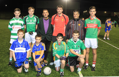 Some of the young players from East Down GAA clubs at the opening night of the gaelic football initiative at St Patrick's Grammar School 3G pitches with Cllr Wiliie Clarke, PCSP Chairman, Peter Turley, Down senior player, and Sean McCashin, East Gown GAA Chairman.