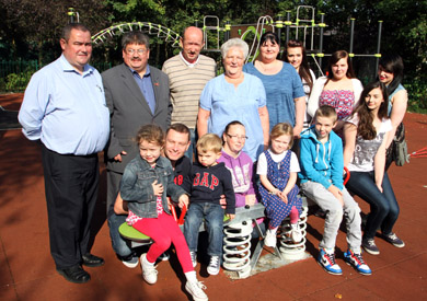 Parents and children at the new Saintfield playpark with Councillors Billy Walker and Terry Andrews, and representatives of the  Saintfield Estates Partnership Ltd members Raymond Cochrane and Sally Welsh (Chairperson).
