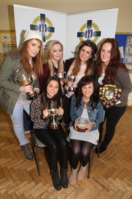 Celebrating the GCE Subject Awards were Rebecca Leung and Rebecca Fotzimomons, with, back row, Chantelle Grieve, Shaleen O'Neill, Alexandra Mooney and Deirdre Venney.