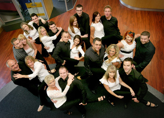 The 11 pairs of dancers meet in the reception at B/E Aeropsace (Kilkeel) for an impromptu rehearsal.