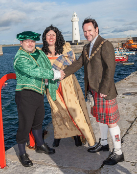 The Scots Have Arrived! Mayor of Ards, Councillor Stephen McIlveen, meets Hugh Montgomery and his wife, first Scottish settlers of the Ards in 1606, who are making a return to Donaghadee for the town's extended weekend of Ulster Scots Thanksgiving events (20 - 24 November).