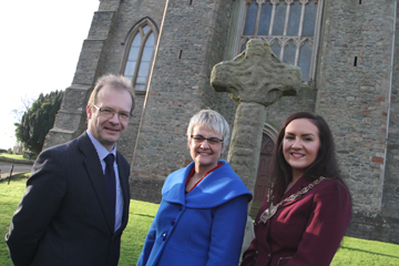 The Curator of Down County Museum, Mike King, with South Down MP Margaret Ritchie and Down District Council Chairman Cl;llr Marie McCarthy look over the Cross which is to be moved to the museum nearby.