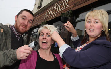 Hair today - gone tomorrow. Rob Manley, owner of the Harbour Bar in Newcastle, with Eileen Byrne who is having her head shaved by hairstylist Emma Travers of CV Hair Design  in Dundrum for Millvale Animal. Sanctuary.