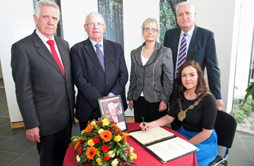 Chairperson of Down District Council, Cllr Marie McCarthy, signs the book of condolence for EK McGrady, former local councillor and MP for South Down. Pictured are John Dumigan, Down Distict Council Chief Executive, Cllr Patsy Toman, South Down MP Margaret Ritchie, and Cllr Eamonn O'Neill.