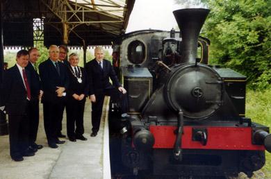 Eddie McGrady, third left, on the platform at Downpatrick rainway station.