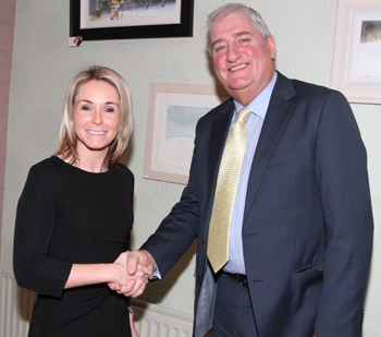 Laura Devlin gets a welcome handshake from Councillor Eamonn O'Neill after she is selected to replace his on Down District Council after a 36 year service.