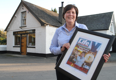 Margaret Ferguson pictured ouside the Lakeside Inn after receiving her award from the Pubs of Ulster.