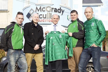Declan Green & partner Brian Scullion from McGradyScullion Solicitors Downpatrick present Downpatrick FC manager Ryan Doyle and players Shane Matheson and Paul Brady with a new strip.