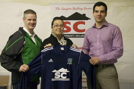 Esther McMenamin & Michael Miskelly from SC Developments presents Tony McShane with a new strip for Downpatrick FC.