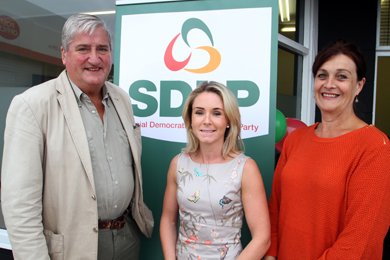Councillor Eamonn O'Neill   with Laura Devlin, Newcastle Constituency Manager, and Councillor Carmel O'Boyle.