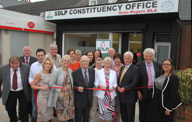 Former South Down MP Eddie McGrady, front centre, pictured at the official opening on Se‡n Roger's constituency office.
