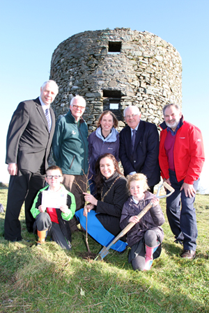 At the launch of the Windmill Hill nature reserve were Coincillor Robert Burgess, Patrick Cregg, Woodland Trust Director, Danielle Begley, Council Biodiversity Officer, and Cllrs Patsy Toman and Garth Craig, with from row, Nathan Cheevers and Halle Lyons from Ballynahinch Primary School with Cllr Maria McCarthy, Chairperson of Down District Council.