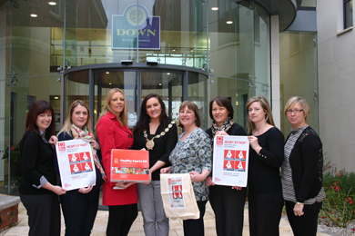 Promoting the heart arrack awareness campaign outside the Down Civic Centre are Heather Holland, Co Down Rural Community Network (CDRCN), Daniella Quinn CDRCN, Stephanie Leckey British Heart Foundation N. Ireland, Councillor Maria McCarthy, Down District Council Chairman, Elaine Hardy, South Eastern HSC Trust, Paula Nixon CDRCN, Lise Curran CDRCN, and Jenny Laverty, Flying Horse Ward Community Forum.