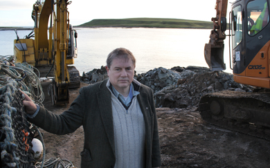 Councillor Cadogan Enright looks over the area at Ballyhornan shoreline where a new waste water pipe is being laid.