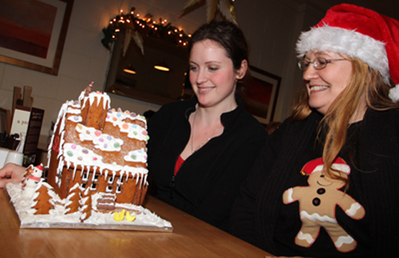Aoife McAleenan, assistant at Mange Tout Deli at Down Business Park in Downpatrick was the lucky winner of a gingerbread Christmas house cake made by Karen McVeigh, office manager at George Lowden Guitars. Karen, an avid cake baker, baked the cake and all donations for the draw went to help the Philipine Disaster appeal. This year Karen baked gingerbread cake guitars for all the staff at George Lowden Guitars which supply to the world's most famous artists such as Snow Patrol.