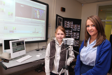 Portaferry Integrated PS pupil Erin Simms with St Mary's High School pupil Caoimhe Connor look over the technology in the Moving Image art room.