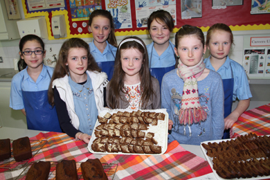 Pupils in the Domestic Science class show off their delicious gingerbread.