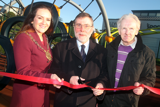 Down District Council Chairperson Cllr Maria McCarthy and Gabriel Trueman, Chair of the Downpatrick Neighbourhood Renewal  Partnership, pictured with DSD MInister Nelson McCausland, centre, curring the ribbon to officially open the new Ballymote playpark in Downpatrick.