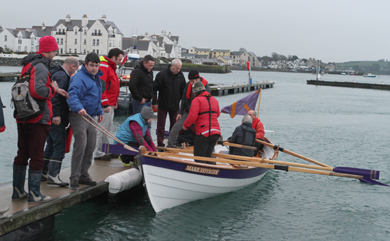 Crews change as the St Ayle's skiff is tested out at Portaferry marina by local boating enthusiasts.