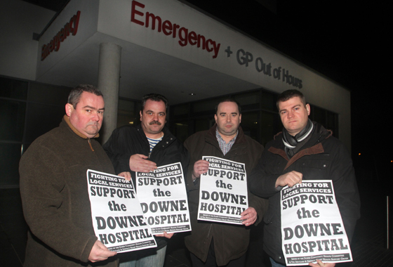Councillors Terry Andrews, Liam Johnston, and Colin McGrath with Down Community Health Committee chairman Eamonn McGrady, second right, outside the Downe Accident and Emergency Department at 10pm when it first closed for the weekend.